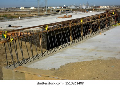 BAKERSFIELD, CA - SEPTEMBER 21, 2019: Exposed reinforcing bars will connect with poured concrete bridge abutments for the Westside Parkway Project now nearing completion.
