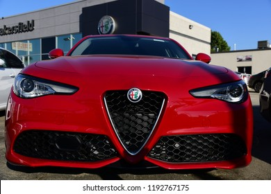 BAKERSFIELD, CA - SEPTEMBER 30, 2018: The distinctive front grill of the new Alfa Romeo Giulia entices prospective buyers to this Central California car lot.