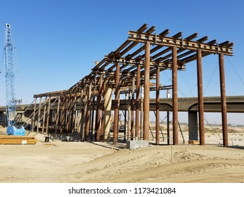 BAKERSFIELD, CA - SEPTEMBER 6, 2018: The steel roadway structure that spans between massive concrete columns is temporarily supported by pipe during construction of the Westside Parkway Project.