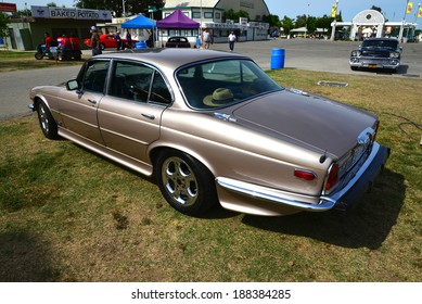BAKERSFIELD, CA-APRIL 19, 2014: The English are represented at the Cruisin' For A Wish Car & Motorcycle Show by this proper sedan, a 1977 Jaguar XJ-6 in bronze paint.