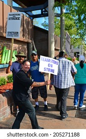 BAKERSFIELD, CA-JULY 15, 2014: After six months failed negotiations the teamsters union strikes the Golden Empire Transit District. Union members walk the picket line in the extreme heat.