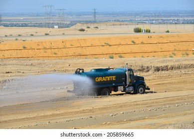 BAKERSFIELD, CA-JULY 18, 2014: This water truck is kept busy during the project to widen State Route 178 so that airborne dust is held to a minimum.