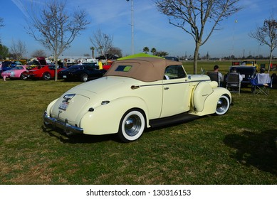 BAKERSFIELD, CA-MAR 2: A completely restored 1937 Oldsmobile convertible arrives at the Cruisin' For A Wish Car & Motorcycle Show on March 2, 2013, in Bakersfield, California.