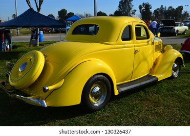 BAKERSFIELD, CA-MAR 2: A very pretty yellow 1936 Ford coupe makes an appearance at the Cruisin' For A Wish Car & Motorcycle Show on March 2, 2013, in Bakersfield, California.