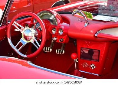 BAKERSFIELD,CA - SEPTEMBER 1, 2019: A nicely preserved 1962 Chevrolet Corvette is on display today at the Hot Rods, Burgers & Beers event. The red theme is carried out min the interior.