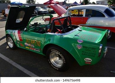 BAKERSFIELD,CA - SEPTEMBER 1, 2019: On display today at the Hot Rods, Burgers & Beers event, is this highly modified 1964 Triumph TR4, built for racing.