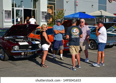 BAKERSFIELD,CA - SEPTEMBER 1, 2019: Proud owners and auto buffs gather to talk cars in the   Hot Rods, Burgers & Beers event. It's early morning but many cars are already lined up.