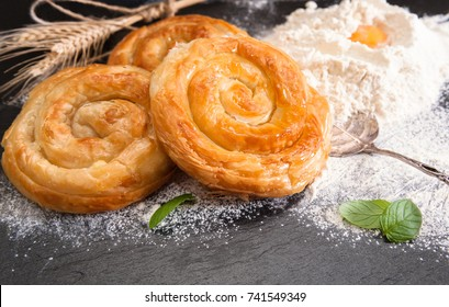 Bakery background – home made cheese pie on black board