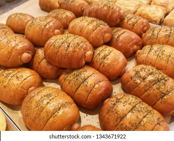 the bakery bread with sausage and on top with aoregano  in plate to sell at supermaket.