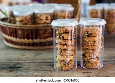 Bakery cookie in plastic jar packaging on table.