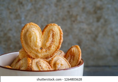 Bakery delicious design from Elephant ear ,Palm leaves, Butterfly shape and Heart about Pies Puff pastry  with butter and  sugar on bowl, Palmier or Coeur de France.