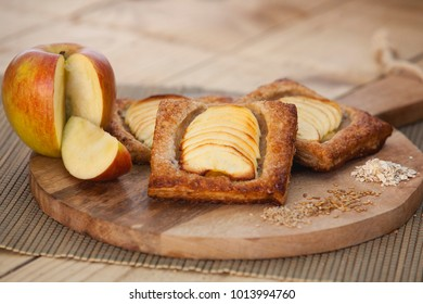 Bakery pastry apple pies on wooden background