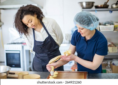 bakery production. African woman chef making cookies