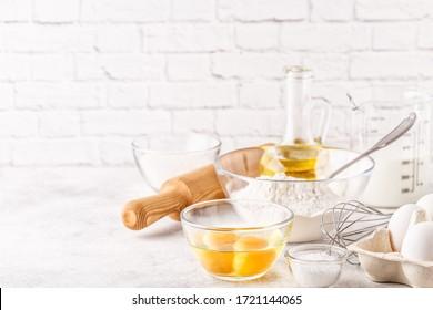 Bakery products -flour, eggs, milk. Selective focus, copy space.