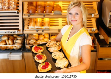 Bakery shopkeeper present different types of cake or pastry
