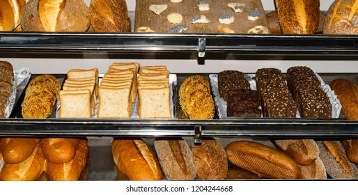 bakery shopping, Top view of assortment of different kind of cereal breads, many mixed bread with poppy, seeds, sesame and grains