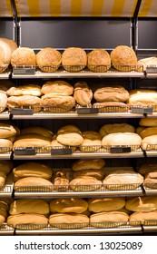 Bakery Store shelves full of various bread.