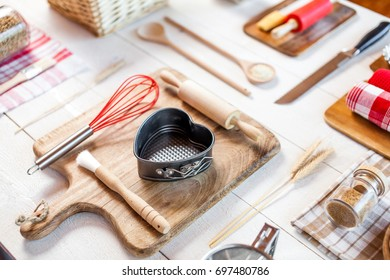 Bakery utensils. Kitchen tools for baking on a rustic wooden table.