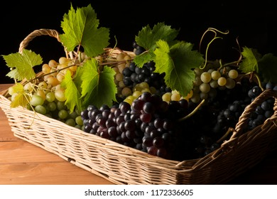 baket with grapes on the wooden table