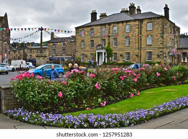 Bakewell, Derbyshire / England - 7/1/2017 : The Rutland Arms Hotel in the centre of the rural town of Bakewell. Pretty flowers and colourful bunting add to this picturesque view.