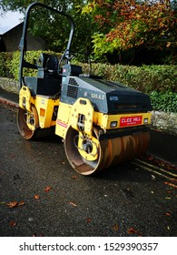 BAKEWELL, UNITED KINGDOM, 10th October, 2019: A yellow steamroller used for construction work or levelling road surfaces on streets and tarmac areas