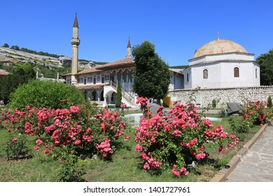Bakhchisarai, Crimea, June 20, 2017. Blooming roses in the garden at the Khan's Palace on a sunny summer day, the cultural and historical heritage of the Crimea