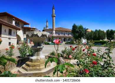 Bakhchisarai, Crimea, June 20, 2017. Fountain and blooming roses overlooking the Khan's Palace on a sunny summer day