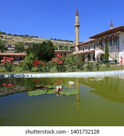Bakhchisarai, Crimea, June 20, 2017. Blooming roses in the garden and a pond with lilies at the Khan's Palace on a sunny summer day, the cultural and historical heritage of the Crimea