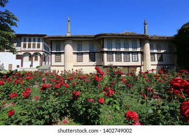 Bakhchisarai, Crimea, June 20, 2017. Beautiful view of the park where red roses bloom and the Khan's Palace on a sunny summer day, the cultural and historical heritage of the Crimea