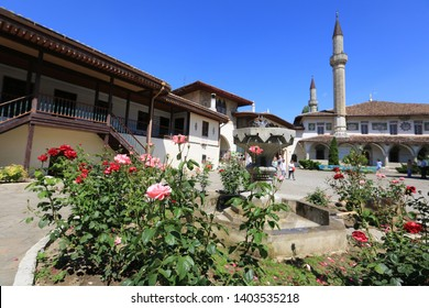 Bakhchisarai, Crimea, June 20, 2017. Blooming roses in the garden and the fountain of the Khan's Palace on a sunny summer day