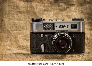 Bakhmut, Donetsk Oblast, Ukraine - January 7, 2021: Classic rangefinder camera. An old camera for 35mm film. Soviet camera FED - 5.