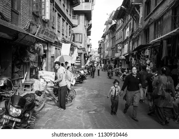 Bakhtapur City, Kathmandu, Nepal - Circa September 2018 - A black and white shot of the street activities in Bakhtapur City, Kathmandu, Nepal visited by the unidentified local people