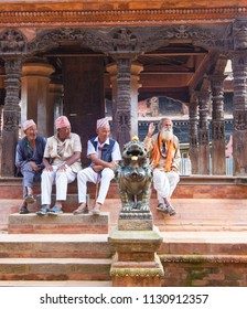 Bakhtapur City, Kathmandu, Nepal - Circa September 2018 - A portrait shot of an unidentified local old men sitting at one of the religious structures in Bakhtapur City, Kathmandu