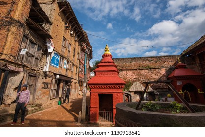 Bakhtapur City, Kathmandu, Nepal - Circa September 2018 - A perspective shot of brickwork building facades and street with an unidentified local men in Bakhtapur City, Kathmandu