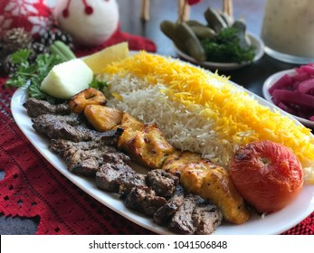 Bakhteyari - one skewer of marinated boneless chickenbreast(jujeh kabob) and one skewer of beef striploin tender(chenjeh kabob) served with griled tomatoes and basmati rice.