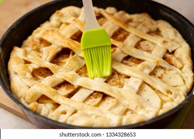baking apple pie and cooking brush