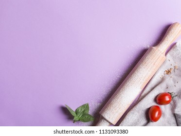 Baking background with copy space on purple surface for your text. Top view. Traditional ingredients for breadmaking and other baking. Often used in Italian cuisine
