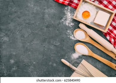 Baking background with eggshell, rolling and baking pin. Background layout with free text space. Top view, flat lay style