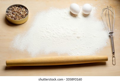 baking background with flour and eggs top view