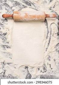 baking background with flour and rustic rolling pin. Top view, place for text.