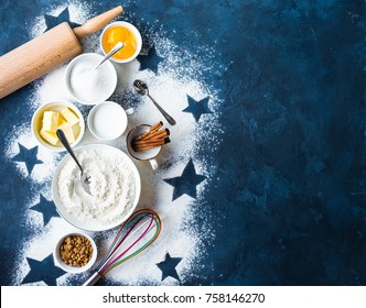 Baking background. Flour, white, brown sugar, eggs, butter, milk, cinnamon sticks, whisk, rolling pin. Ingredients for baking. Kitchen utensils. Space for text. Top view. Making baked goods. Concept