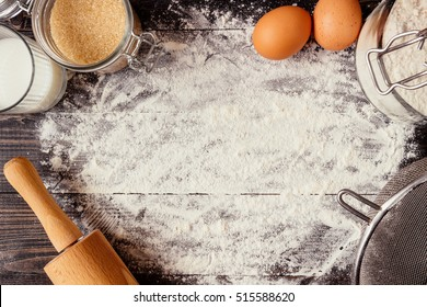 Baking background. Baking ingredients with copy space on the wooden dark table