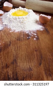 baking background  with raw egg and flour. Space for text