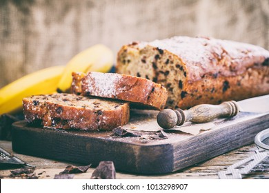 Baking with Banana and Chocolate. Holiday Cake. Dessert.Sladky Pie  with sprinkled sugar powder.Toned image Vintage style  - Shutterstock ID 1013298907