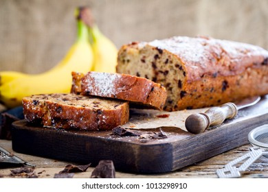 Baking with Banana and Chocolate. Holiday Cake. Dessert.Sladky Pie  with sprinkled sugar powder. - Shutterstock ID 1013298910