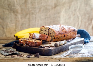 Baking with Banana and Chocolate. Holiday Cake. Dessert.Sladky Pie  with sprinkled sugar powder. - Shutterstock ID 1013298913