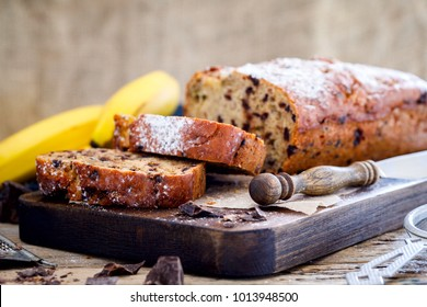Baking with Banana and Chocolate. Holiday Cake. Dessert.Sladky Pie  with sprinkled sugar powder. - Shutterstock ID 1013948500