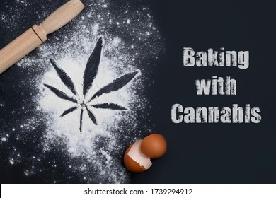Baking with cannabis concept. Top view of cannabis leaf made of flour with eggshells and rolling pin and text Baking with Cannabis