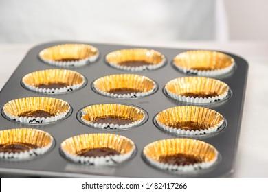 Baking chocolate cupcakes in cupcake pan.