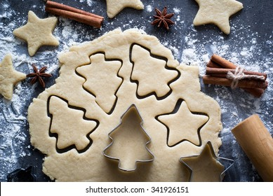 Baking Christmas cookies -  dough on the table, cookie cutters and cookies.